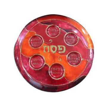 תמונה של צלחת פסח מזכוכית גווני אדום וכתום