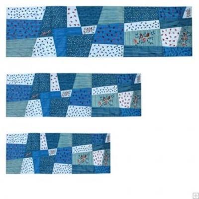 """תמונה של ראנר לשולחן ממשי פראי עם ריקמת טלאים """"רימונים"""" (כחול) - יאיר עמנואל"""