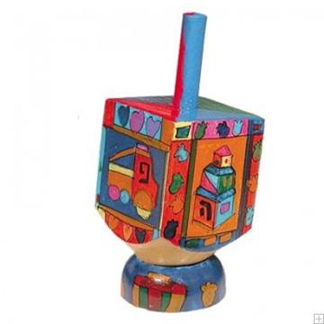 """תמונה של סביבון קטן מעץ עם תושבת """"צעצועים"""" - יאיר עמנואל"""