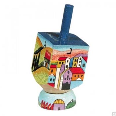 """תמונה של סביבון קטן מעץ עם תושבת """"נוף ירושלים העתיקה"""" - יאיר עמנואל"""