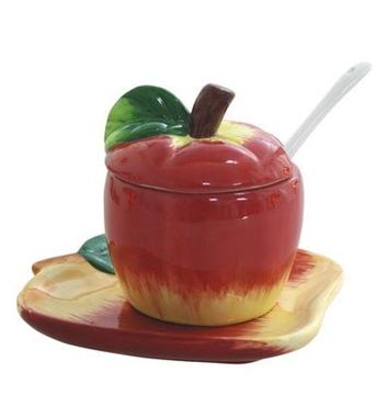 """תמונה של כלי לדבש מקרמיקה עם תחתית """"תפוח"""""""